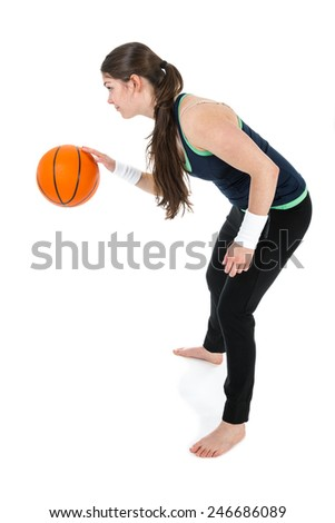 Young woman is playing basketball, isolated on white - stock photo