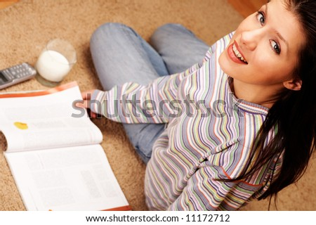 young woman is reading the magazine - stock photo