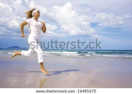Young woman is running near the ocean. Space for copy - stock photo