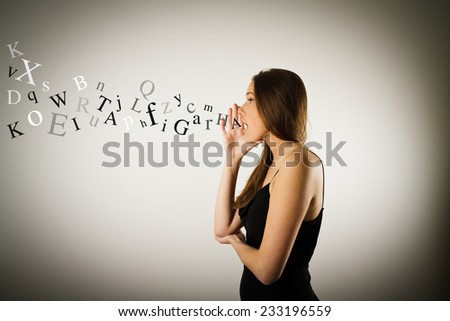 Young woman is screaming at something. Young woman is doing something. - stock photo