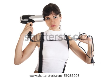 Young woman is shooting herself from hairdryer - stock photo