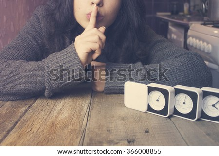 young woman is silenced-clock - stock photo
