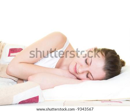 Young woman is sleeping in her bed. Isolated. - stock photo