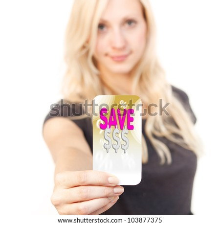 Young woman is smiling while showing bargain Card - stock photo
