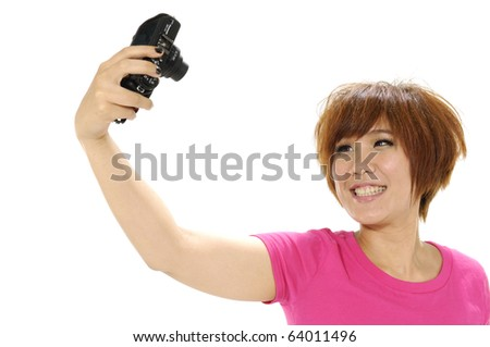 Young woman is taking photos with the mobile phone camera, - stock photo