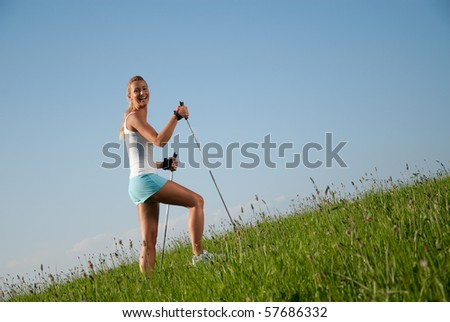 young woman is walking in her spare time - stock photo
