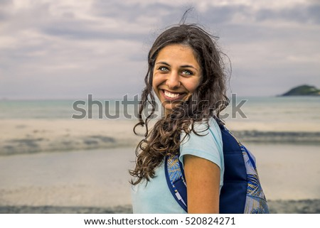 Young woman is walking on the beach of Norway