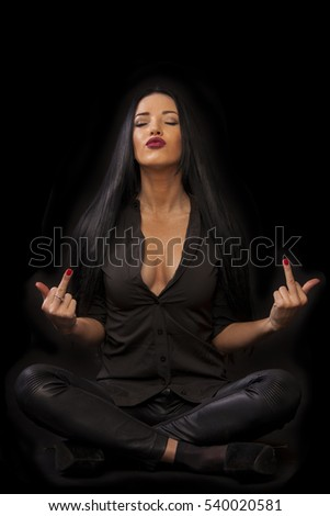 Young woman isolated on black background showing middle fingers