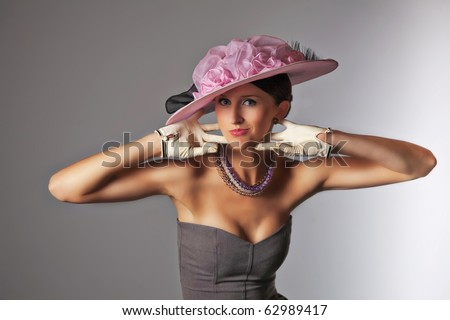 Young woman isolated on gray vintage hat and syle - stock photo