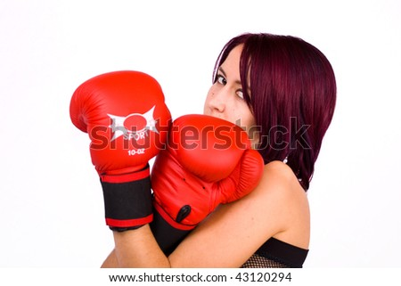 young woman isolated on white playing boxe