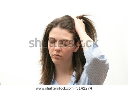 Young woman isolated over white background with a headache