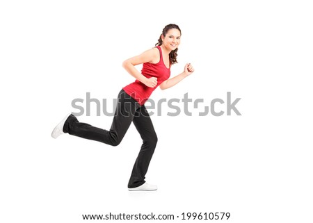 Young woman jogging and looking at camera isolated on white background