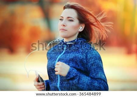 Young woman jogging at park - stock photo