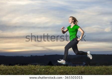 young woman jogging in sundown - stock photo