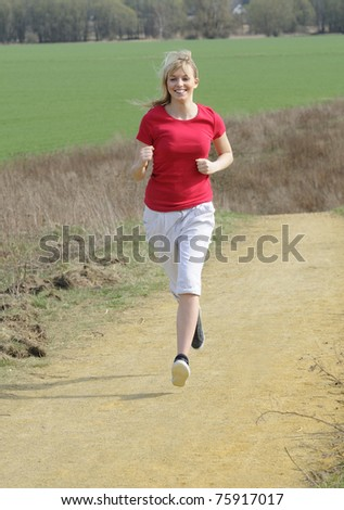 young woman jogging on a dirt road