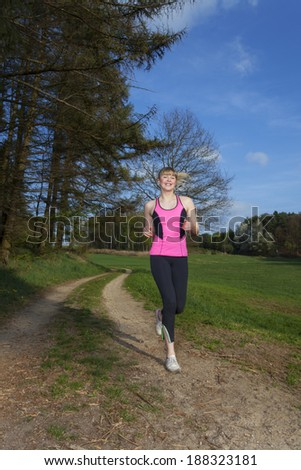 young woman jogging with motion blur