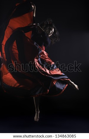 Young woman jump in spanish flamenco with passion