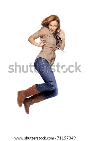 Young woman jumping - stock photo