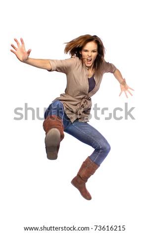 Young woman jumping and kicking - stock photo