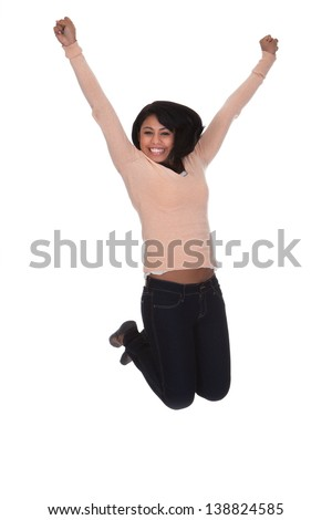 Young Woman Jumping In Joy Over White Background - stock photo