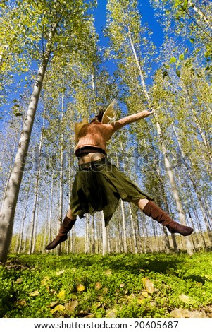 Young woman jumping in the forest