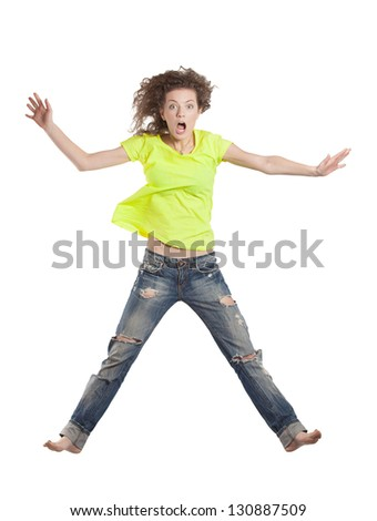 young woman jumping looking surprised - stock photo