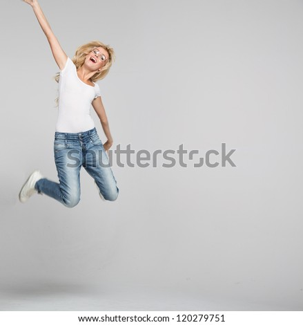 young woman jumping on white background - stock photo