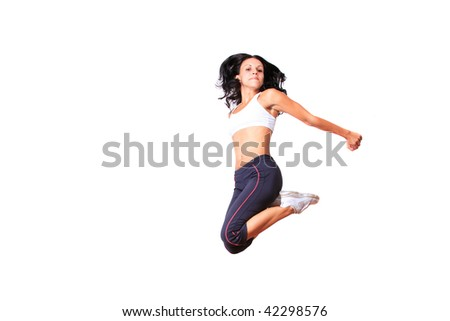 Young woman jumping while exercising