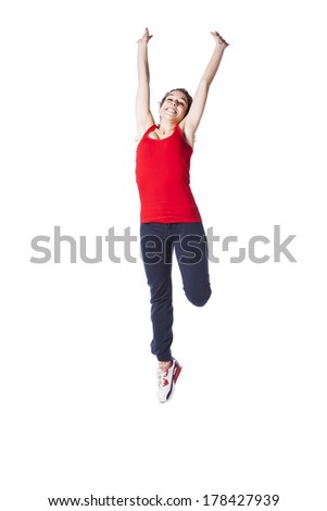 Young woman jumping with exercise clothes (isolated on white) - stock photo