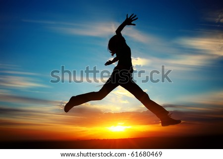 Young woman jumping with raised hands