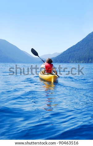 Young woman kayaking on Lake Crescent, Olympic National Park, Washington, USA - stock photo