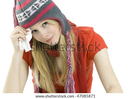 young woman keeping a paper handkerchief in winter clothes - stock photo