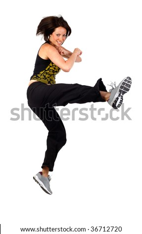 young woman kick boxing studio shot on white - stock photo