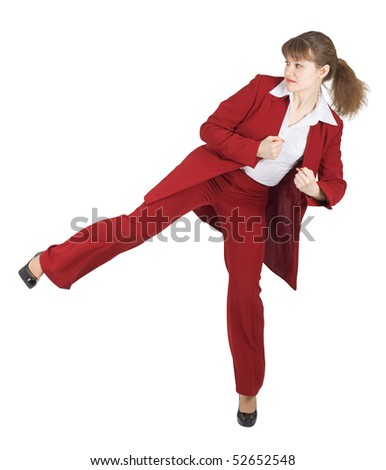 Young woman kicked on a white background - stock photo