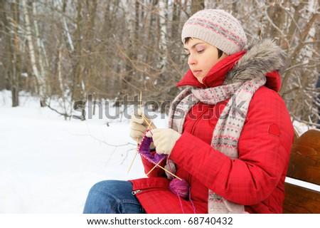 Young woman knitting - stock photo