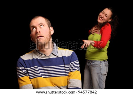 young woman laughing about her boyfriend - stock photo