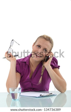 Young woman laughing on the phone - stock photo