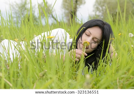 Young woman laying on meadow