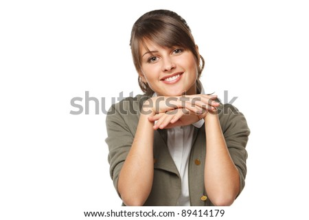 Young woman leaning on her elbows, isolated on white background