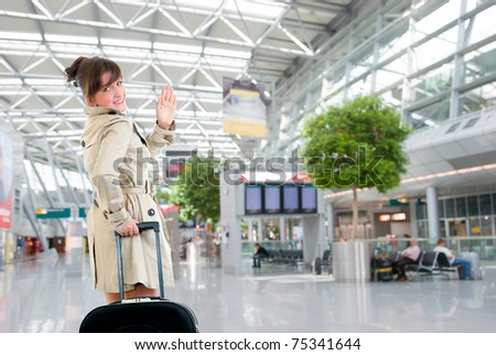 Young woman leaving at the international airport - stock photo