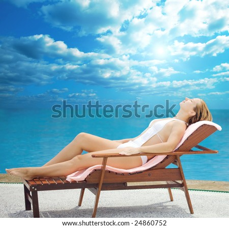 Young woman lies near the ocean - stock photo