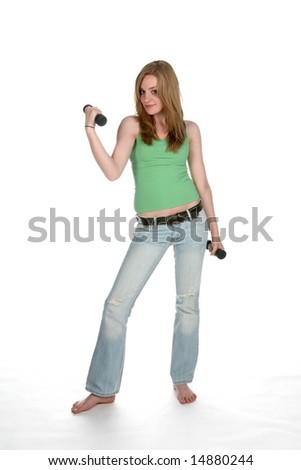 young woman lifting barbells - stock photo