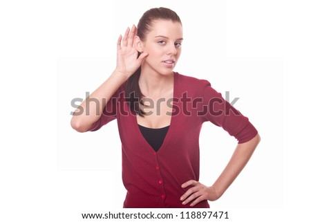 young woman listen carefully whisper or gossip putting hand to ear - stock photo