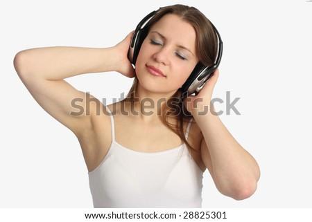 Young woman listen music in headphones - stock photo