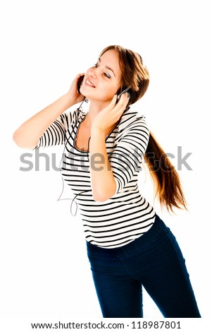 young woman listen music isolated on a white background - stock photo