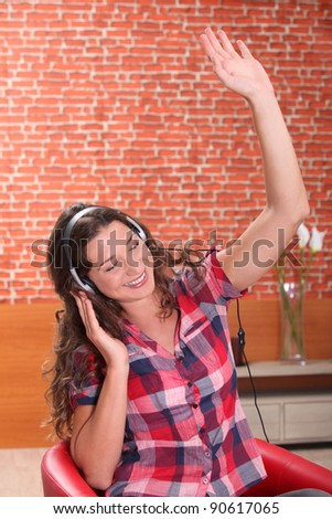 young woman listening and enjoying music - stock photo