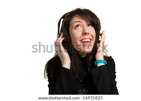 Young woman listening music and singing - stock photo