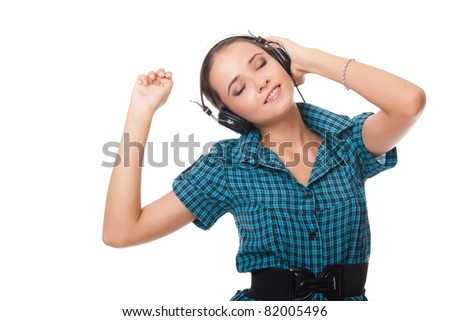 young woman listening music in headphones on white background - stock photo