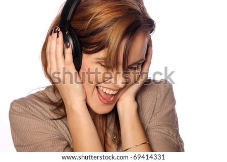 Young woman listening to headphones - stock photo