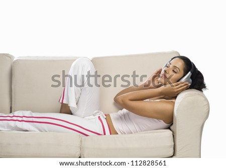 Young woman listening to music - stock photo